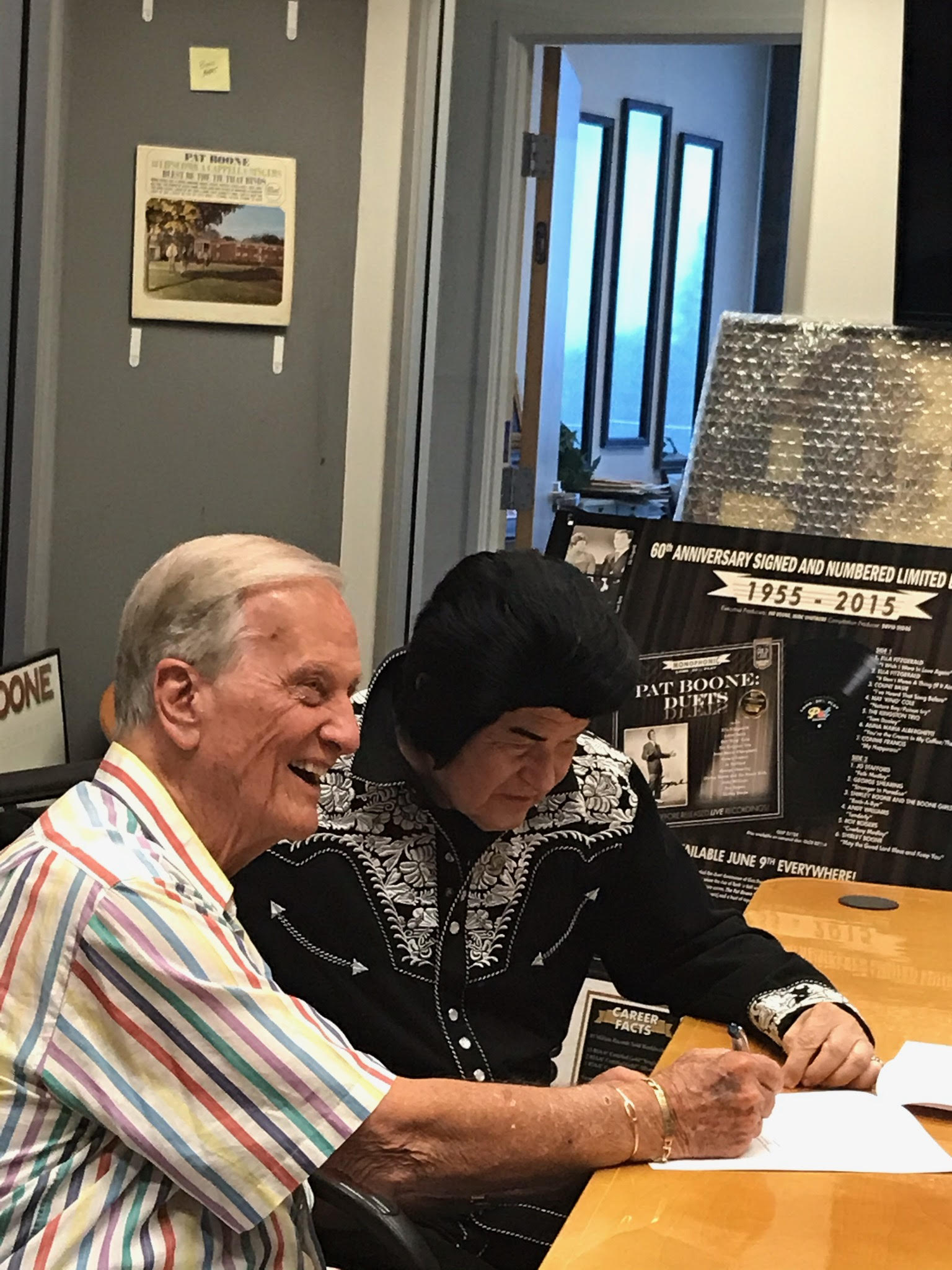 At his memory-filled corporate headquarters near Hollywood, music icon Pat Boone, a teen idol alongside Elvis Presley in the 1950s, welcomes a fellow teen idol and longtime friend, Jimmy Angel.